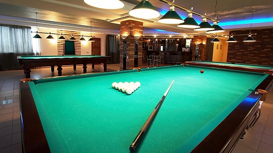 The game room offers a variety of games and has a big screen TV.