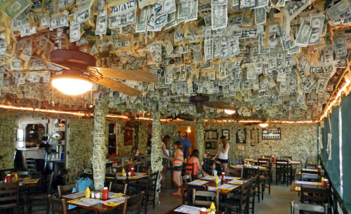Cabbage Key restaurant has over $70,000 in $1 bills taped to its ceiling and walls.